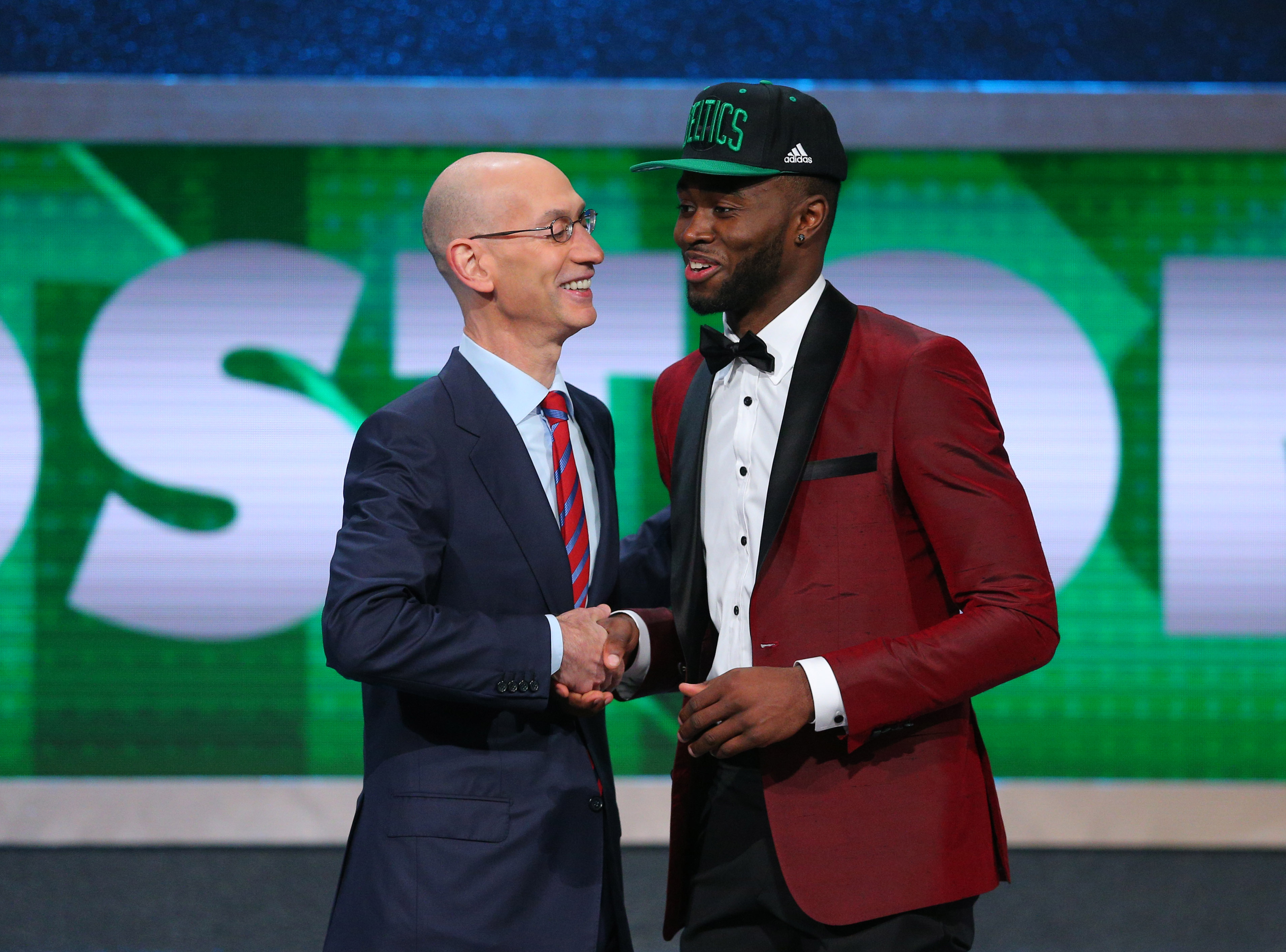 Jun 23, 2016; New York, NY, USA; Jaylen Brown (California) greets NBA  commissioner Adam Silver after being selected as the number three overall  pick to the ...